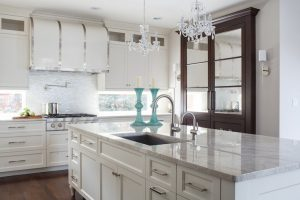white cabinets with chandelier